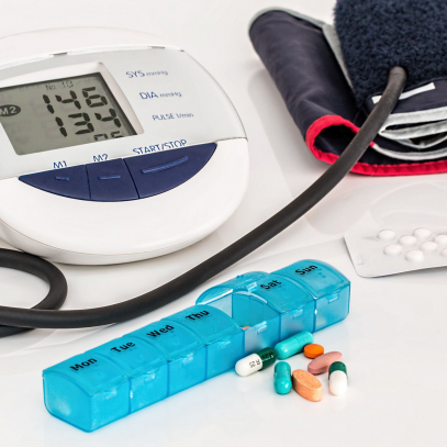 Blood pressure cuff and pills